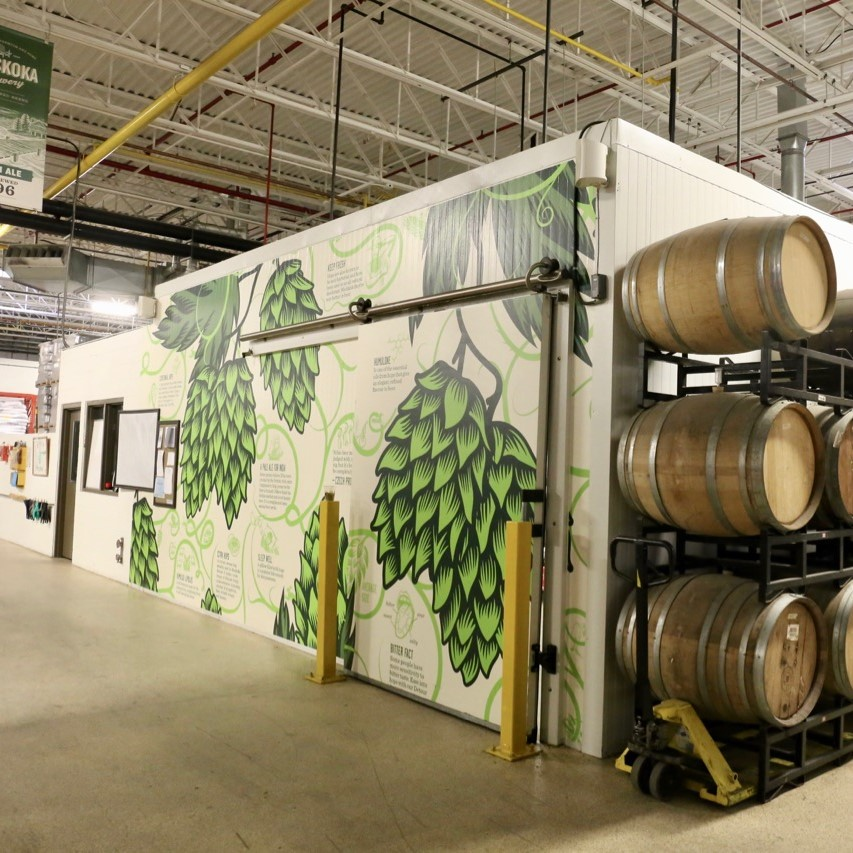 Muskoka Brewery's painted hop fridge and view of the aging barrels.