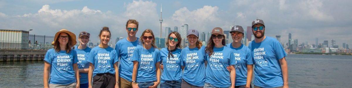 swim drink fish. Toronto Island shore clean up