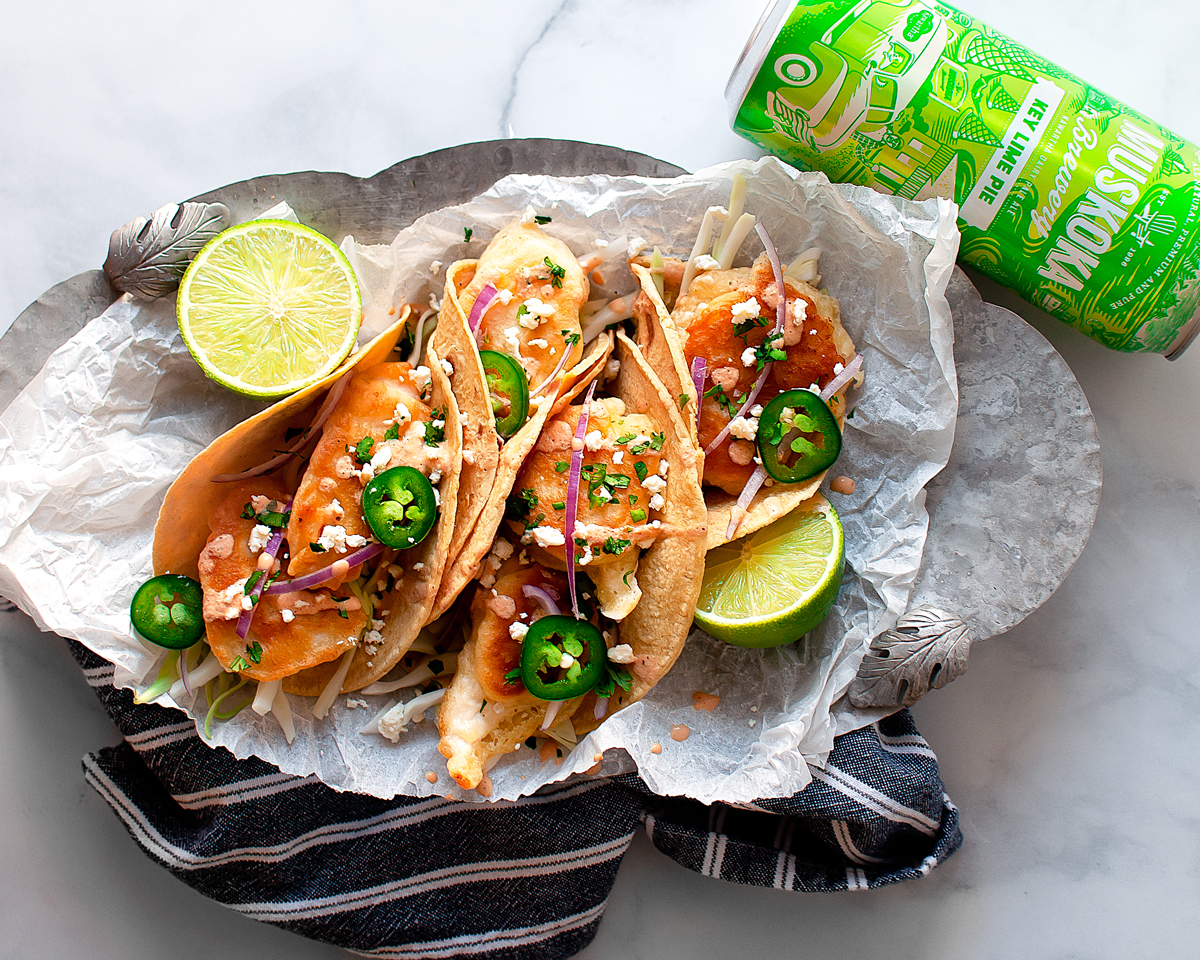Tacos and beer with slices of lime