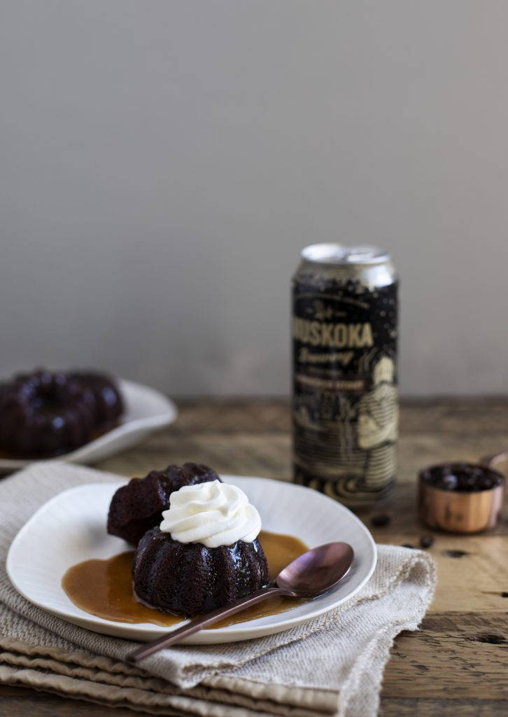 Sticky Pudding topped with whip cream, resting in toffee sauce witha can of Shinnicked Stout on the side.