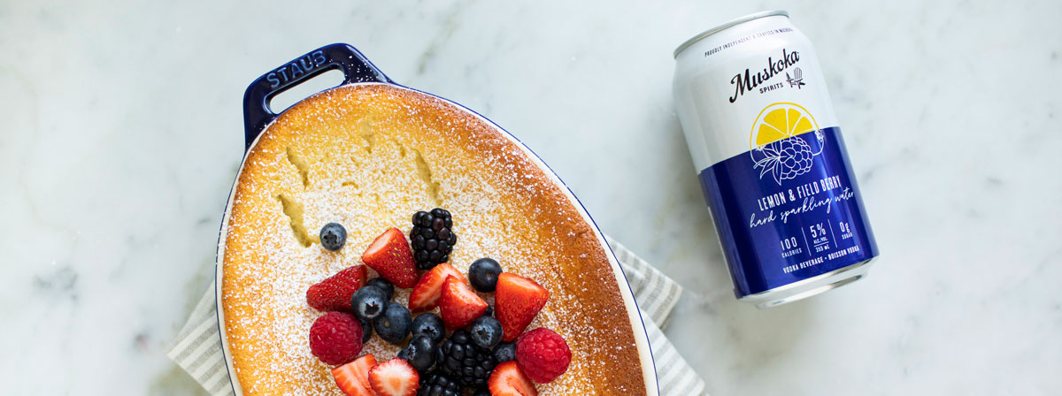 Pudding cake and can of Field Berry & Lemon Hard Sparkling Water