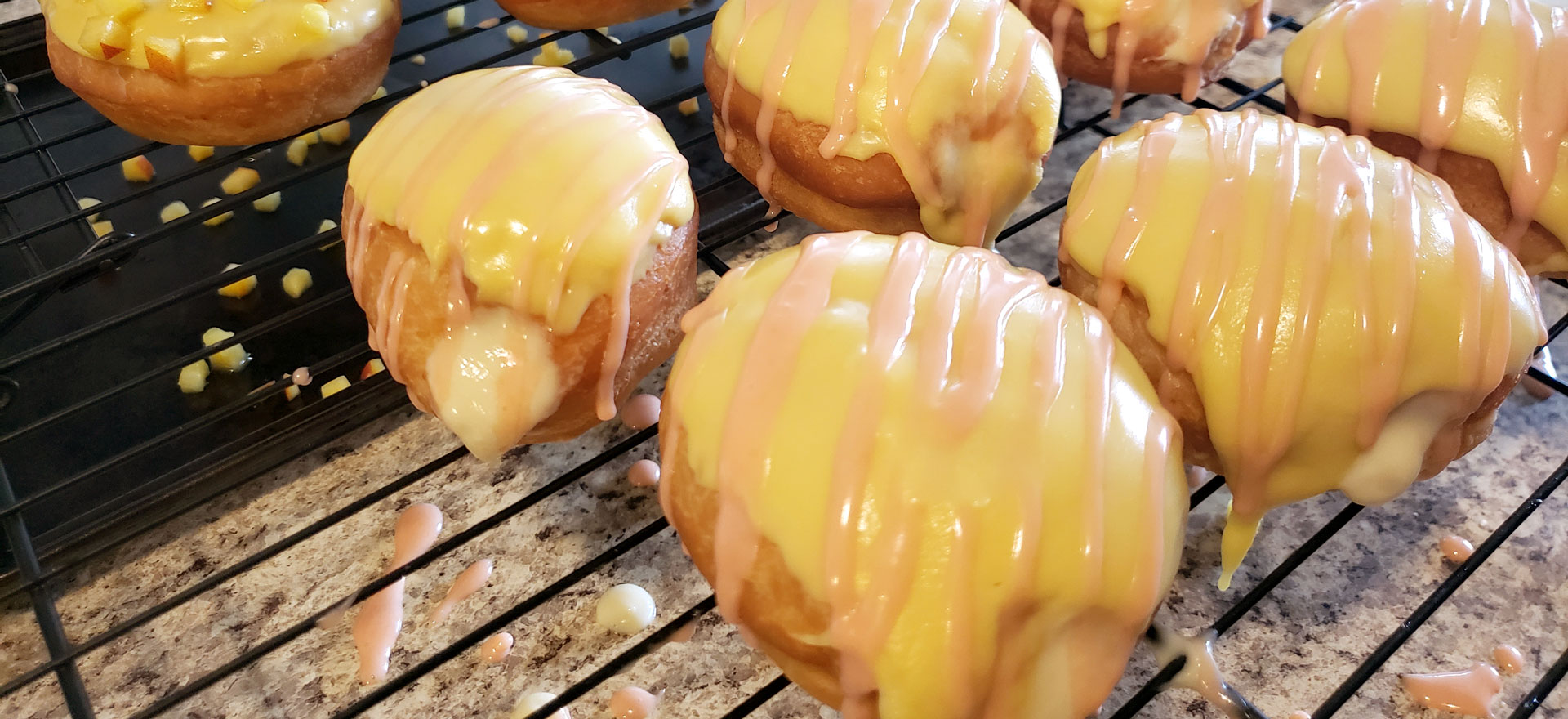 Pastry cream donut with cream and pink frosting